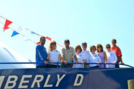 People aboard crew boat